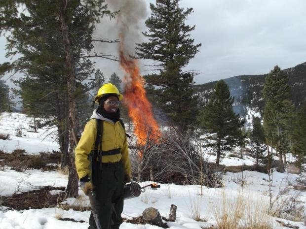Firefighter burns piles near Boulder in early 2015
