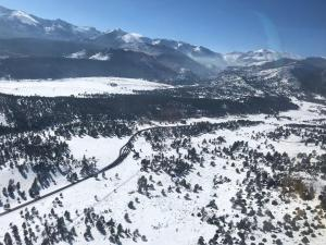 snow at RMNP entrance, aerial view