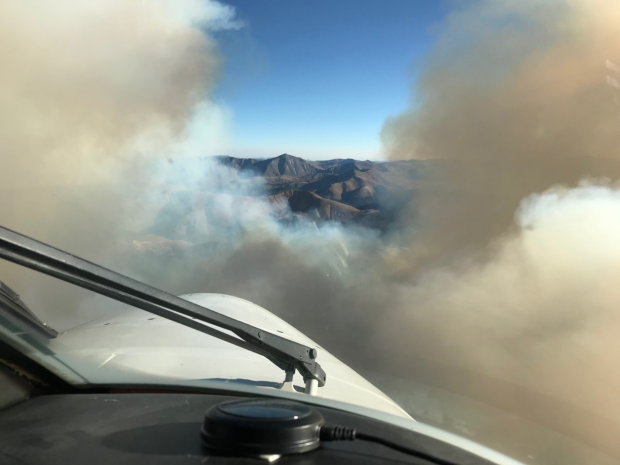 Air attack from the pilot's view, looking through a gap in the clouds of smoke.