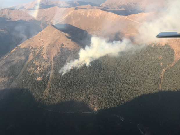 An aerial photo of Jones Pass with visible smoke.