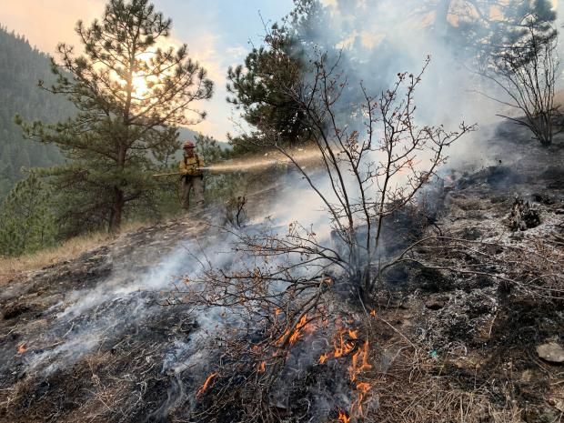Firefighters working along Lefthand Canyon Road on October 19.