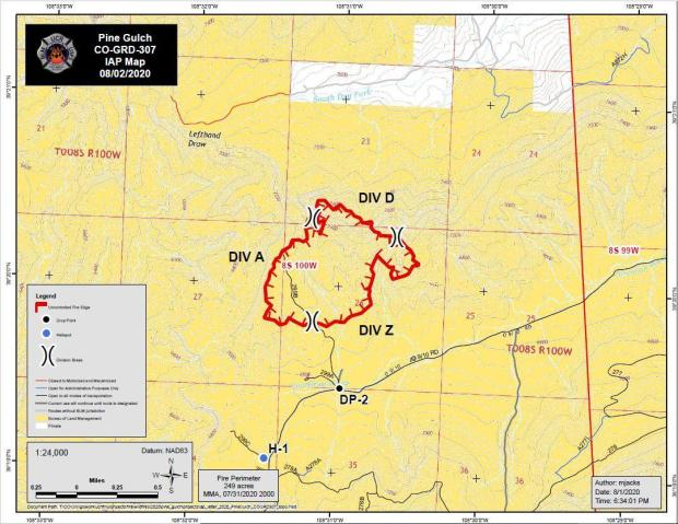 The topographic map shows a red boundary around the fire perimeter. Topographic lines illustrate landscape relief. Yellow areas are BLM lands, white areas are private land.