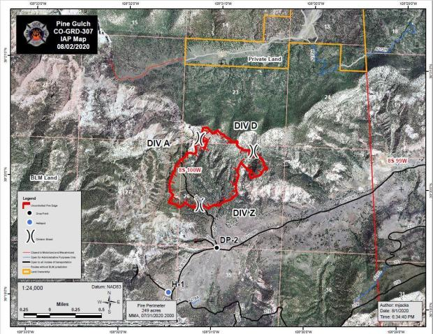 The map shows a red boundary around the fire perimeter over an aerial view of the landscape.