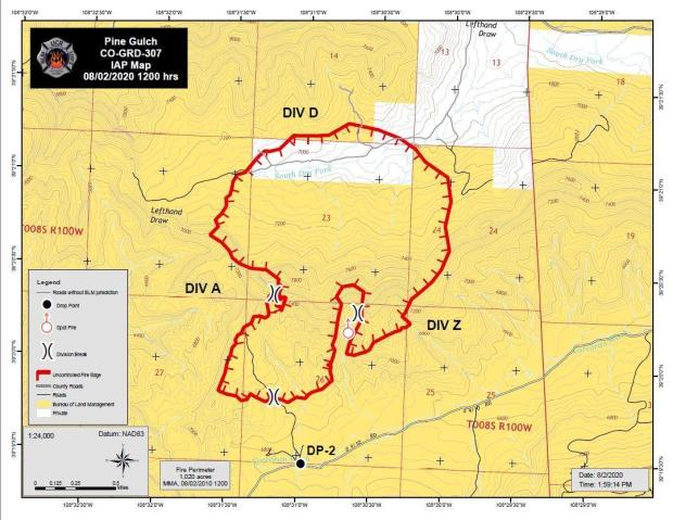 The map shows the fire perimeter as a red line over a topographic map.