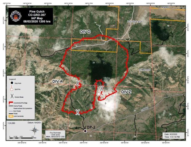 The red line shows the fire perimeter over an aerial view of the fire area.