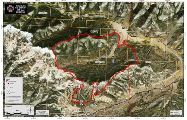 The map shows the fire perimeter in red overlaid on an aerial view of the fire area.
