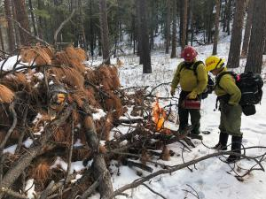 Crews lighting a pile on Columbine Ranger District