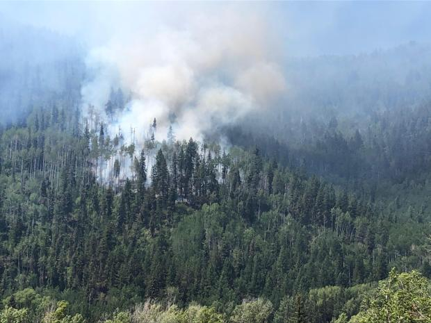 Loading Pen Fire burning midslope in mixed conifer and aspen.