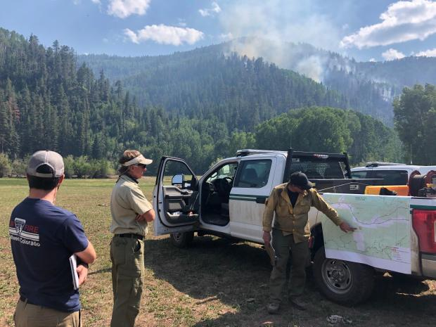 Firefighters discuss plans for the Loading Pen Fire