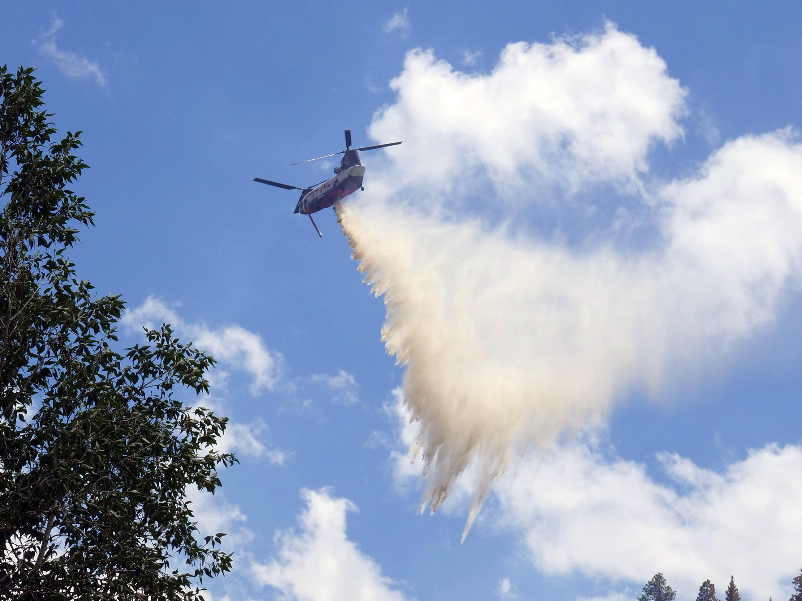 A Chinook helicopter drops its load of water on the Loading Pen Fire near Dolores Tuesday.