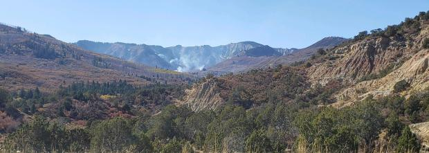 This photo shows activity near Middle Mamm Creek on Sunday, October 13. Interior pockets of fuel continue smoldering while crews are mopping up control lines around the fire's perimeter.