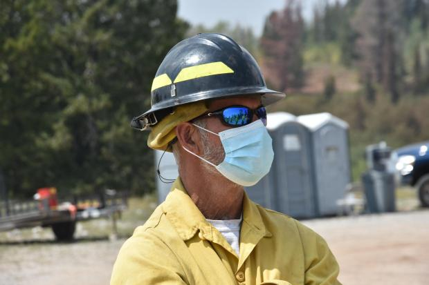 Grizzly Creek Fire firefighter with COVID-19 PPE