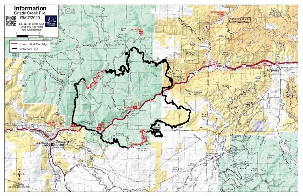 Uncontained fire line is red on a topographic map of the area