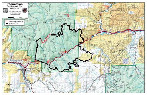 Uncontained fireline is red on a topographic map of the area