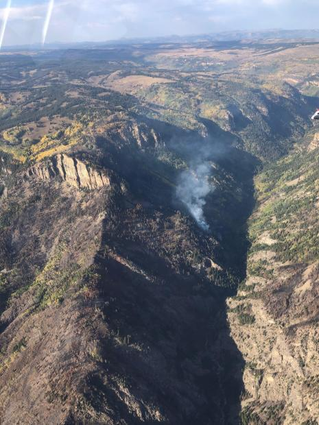 Looking northeast, this aerial view of Grizzly Creek Drainage shows a single plume of smoke.