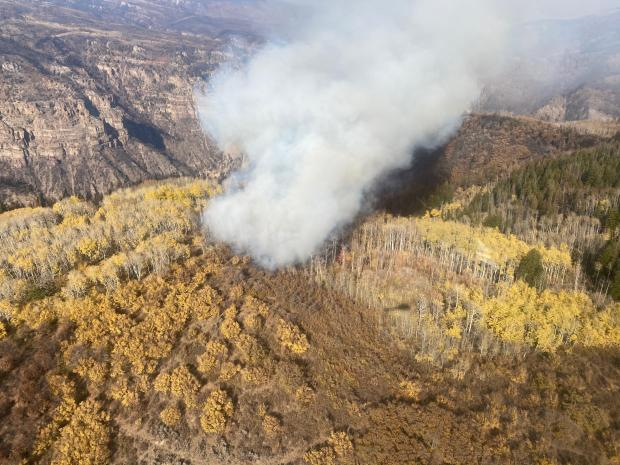 An aerial view of a small smoke plume coming from the area of Devils Hole within the Grizzly Creek Fire burn area.