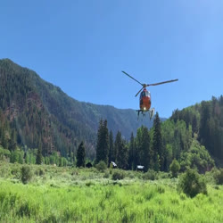 A helicopter takes off from Sylvan Lake to recon the Sylvan Fire.