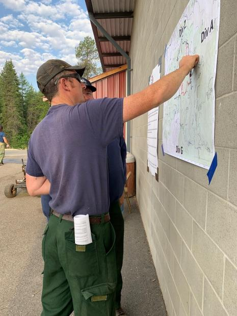 Firefighters look at map of fire