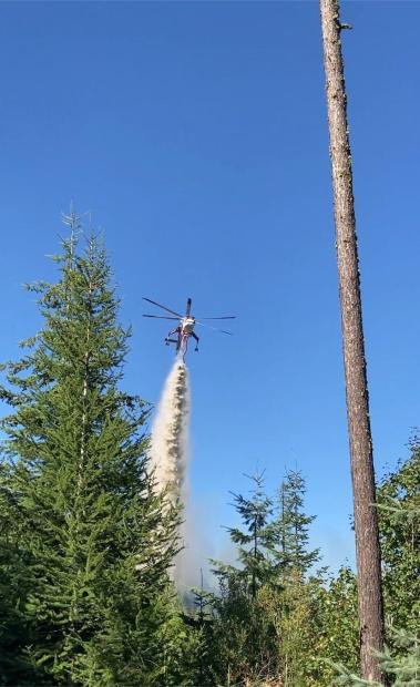 Sky crane dropping water on Sand Mt.Fire