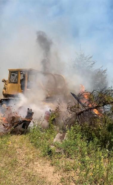 Dozer directly engaing fire on Sand Mountain