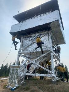 Surveyor's Lookout being wrapped by Smoke Jumpers