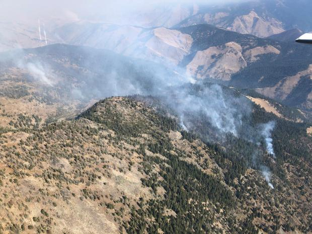 Smoke rises from the Bryan Mountain fire in this photo taken by aircraft.