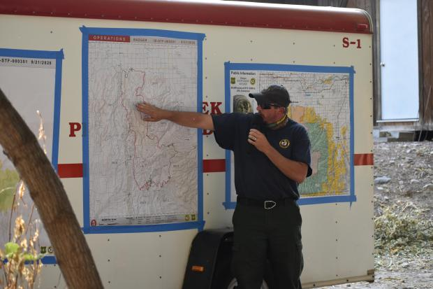 Photo of Eric Nolan pointing out locations on a map.
