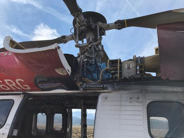When the helicopter comes in from a run to fuel or wait for the next assignment they open the casing around the rotor to cool it off