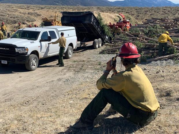 Safety lookout at chipping site Jakes Gulch Fire