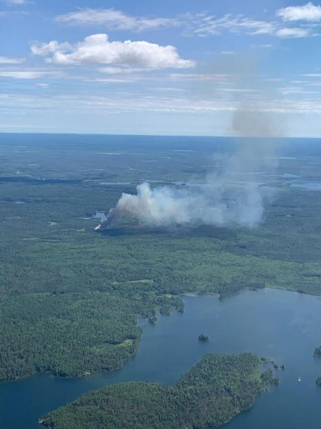 Aerial view of the Delta Lake Fire. Shows the horizon, clouds, and landscape