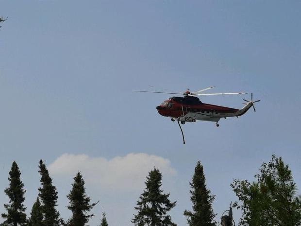 Helicopter dipping on Delta Lake Fire