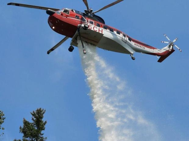 Helicopter making drops on Delta Lake