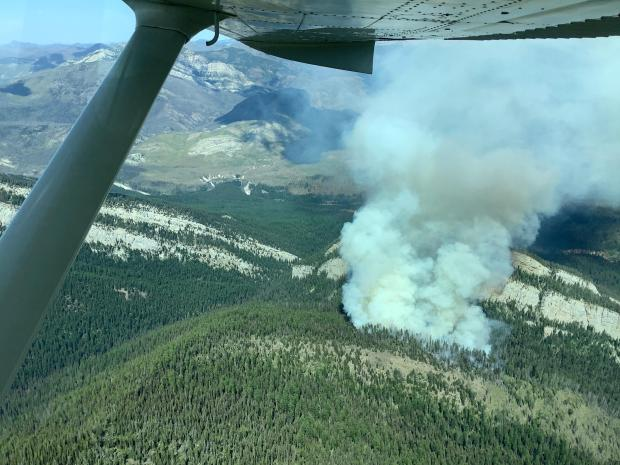 The Snow Creek Fire observed looking east on August 4th, 2019. The fire can be seen spreading towards the east and upslope towards the top of the ridge that separates the Snow Creek drainage to the south and the Hungry Creek drainage to the north.