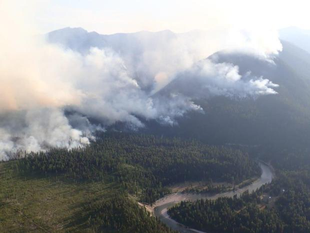 The Snow Creek Fire as seen looking southwest over the Black Bear Administrative site. The fire can be seen actively burning on the west side of the river near Helen Creek, in the Snow Creek drainage, and moving into Hungry Creek.