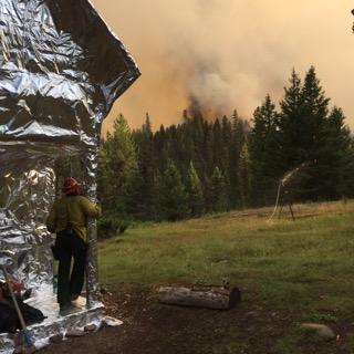 Snow Creek Fire personnel conducted burnout operations on the evening of August 7th and 8th to further protect historic structures at the Black Bear Administrative site. Photo by Caleb Fossee.