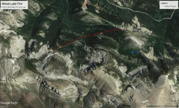 Google earth image with white line illustrating fire perimeter, red line revealing retardent line, and blue lettering identifying Alpine Lake