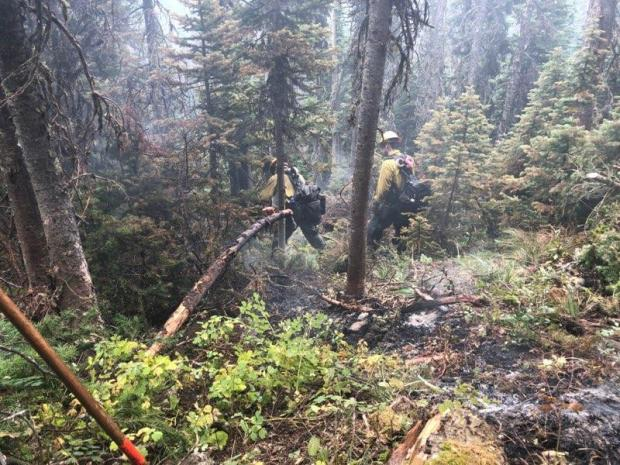 Firefighter working interior to the Wood Lake Fire