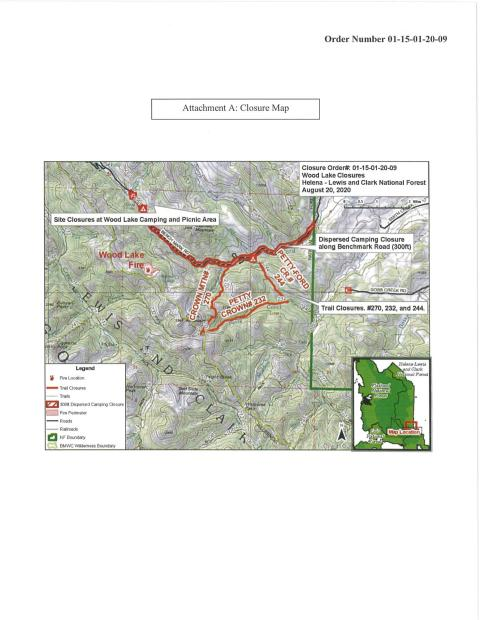 Woods Lake are topographical map.  Closed trails are highlighted with a thin red line.  Dispersed camping prohibition area on Benchmark Road highlighted with a heavy red line from Forest Boundary to Wood Lake.  Wood Lake site symbols are red.
