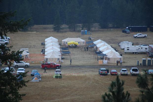 8/8/2021 Burnt Peak Fire Incident Command Post, two rows of large tents in a field.