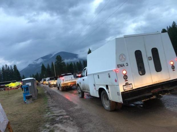 Crews heading out from camp on the rainy morning of Aug. 22