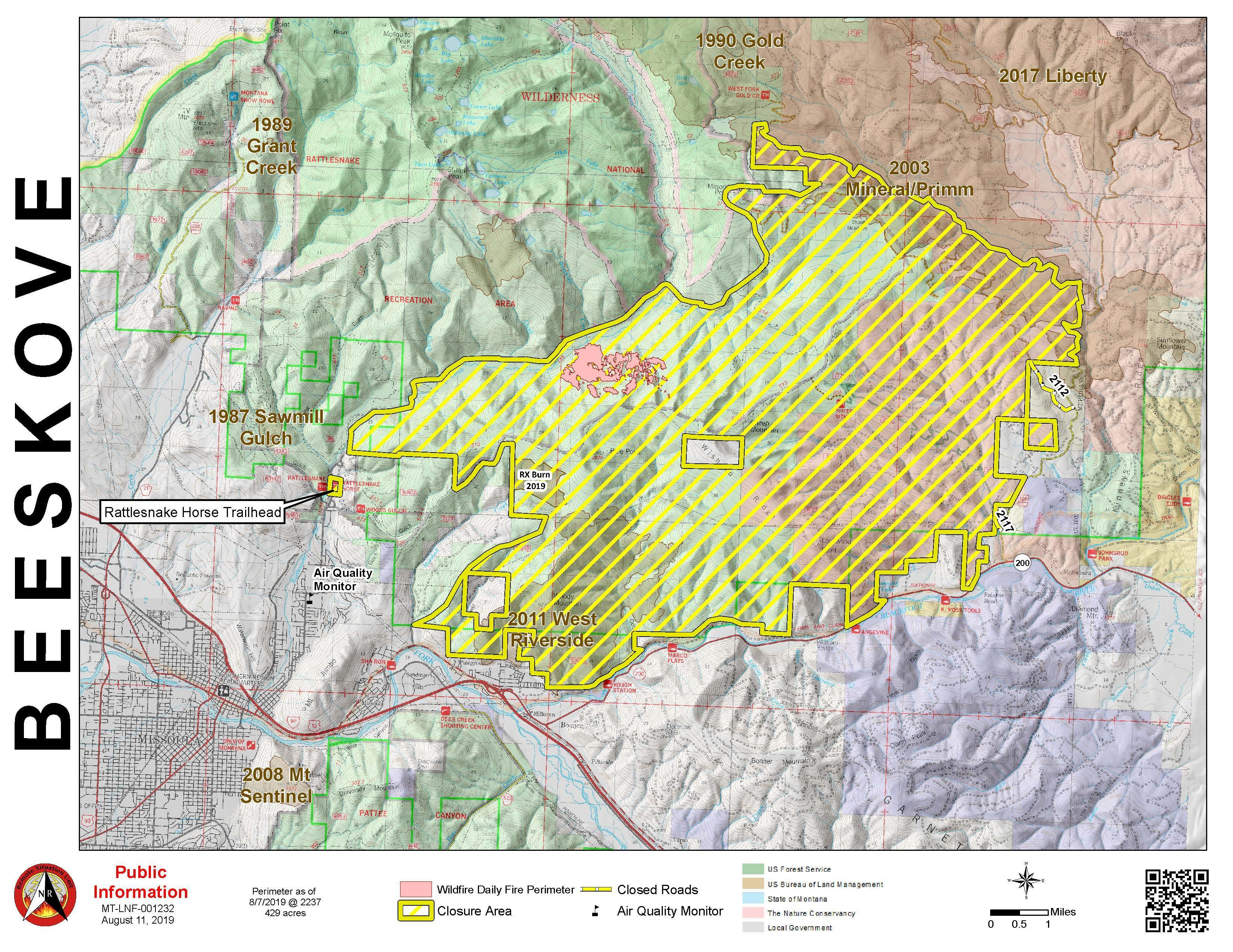 Map with pink polygon highlighting fire area and yellow polygon highlighting closure area