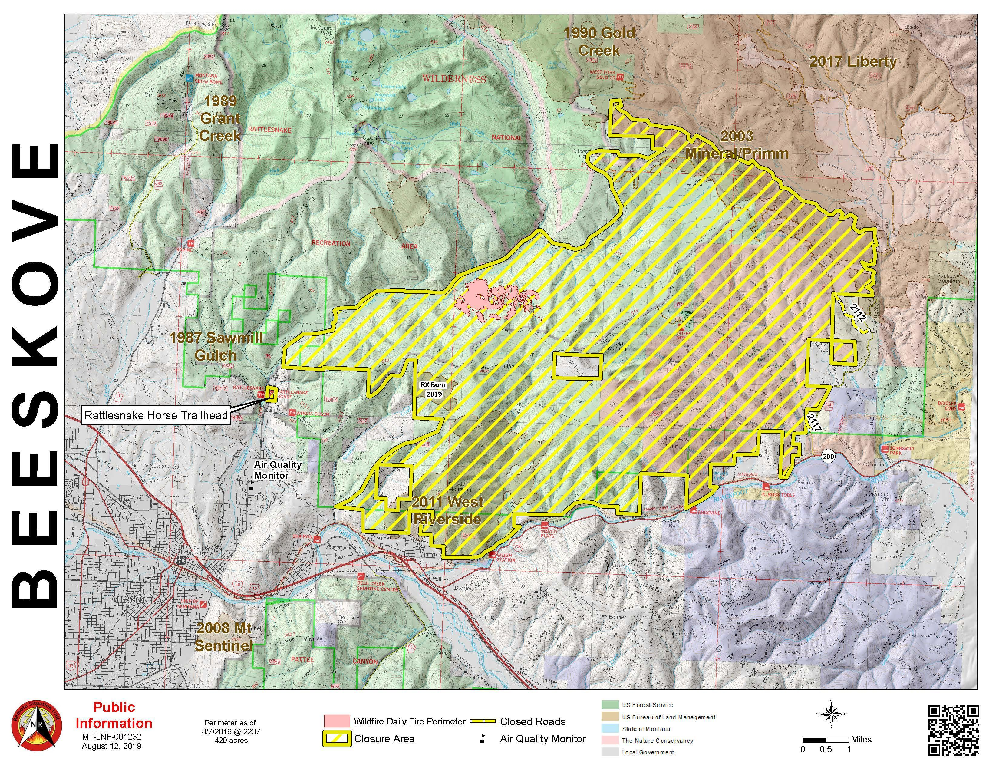 Map with pink polygon denoting fire perimeter and a yellow polygon denoting the closure area.