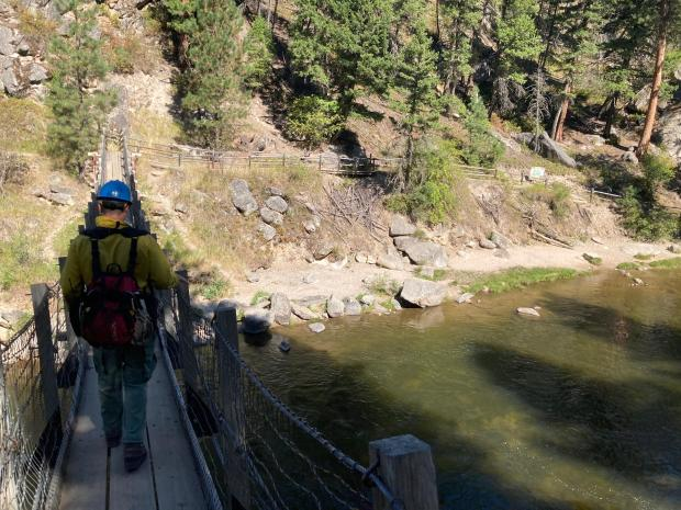 Firefighters crossing into Welcome Creek Wilderness