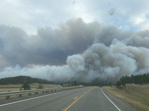 Large smoke column blowing across the highway