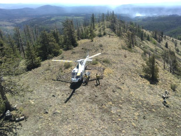 Looking down on helicopter landed at Fire Lookout on Johnson Fire support mission