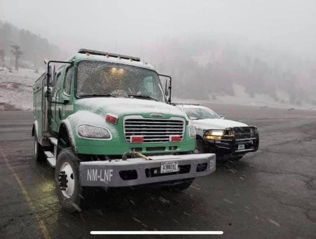 Snow accumulating on Forest Service vehicles assigned to the Three Rivers Fire.