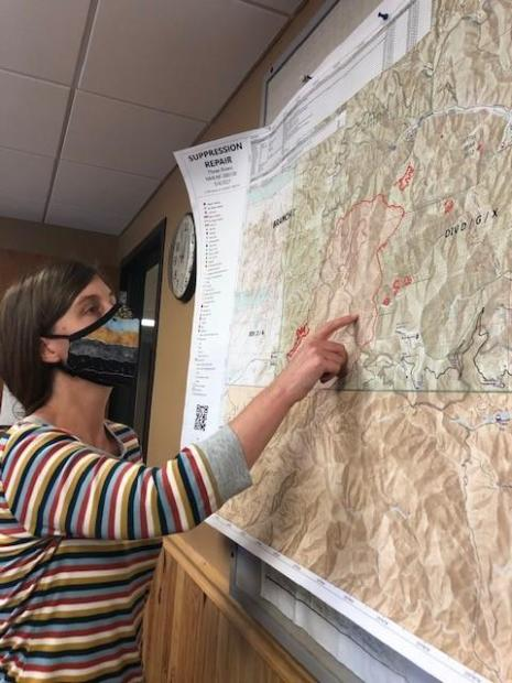 On May 12th, Soil Scientist studies the map of the Three Rivers Fire to determine what areas to examine during her site visit to the fire on the following day.