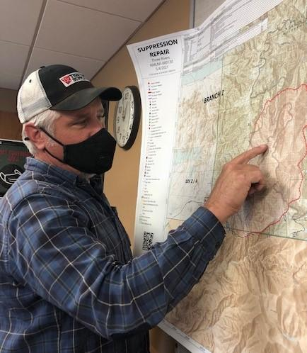 Soil Scientist hones in on the map to plan for the field assessment on the following day.