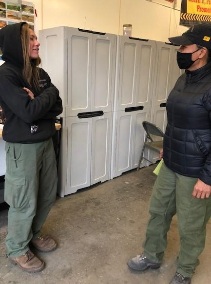 Firefighter (left) and BAER Team leader for field operations (right) have a safety discussion prior to heading to the Three Rivers Fire.