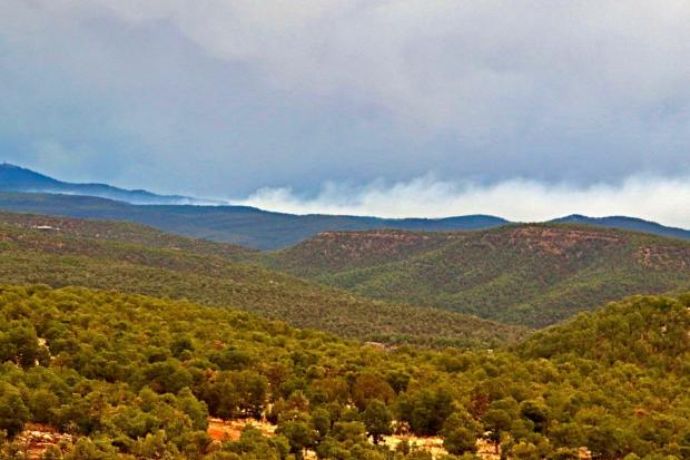 view toward Cuervito Fire from Rowe, NM_low-lying smoke
